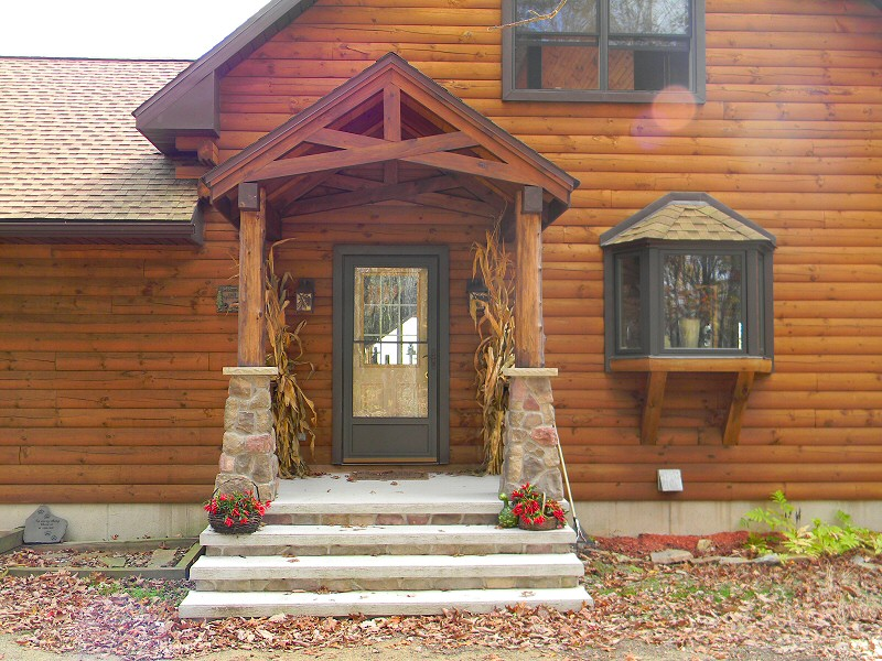 Log home addition home design for Timber frame porch addition