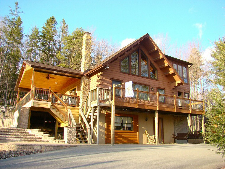 Log homes log cabins timber frame custom log homes poconos for Custom luxury log homes